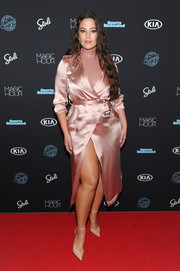 Ashley Graham looked alluring in a pink satin trenchcoat by Fleur du Mal at the Sports Illustrated Swimsuit 2018 launch event.