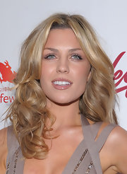 Abbey Clancy wore her hair in bouncy curls for the Sports Illustrated Swimsuit 24/7 launch party.