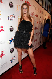 Cintia Dicker channeled punk chic as she wore an edgy fringe dress and a pair of gladiator heels at the Sports Illustrated event held at The Mirage.
