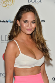 Chrissy Teigen wore her hair down in sexy waves during the Sports Illustrated Swimsuit South Beach Soiree.