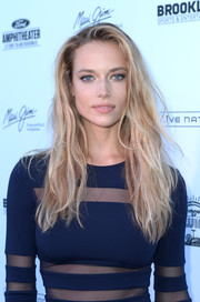 Hannah Ferguson teased her long blonde locks into a messy-sexy style for the SI Summer of Swim Fan Festival.