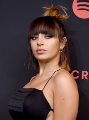 Charli XCX went for an edgy half-up knot with eye-grazing bangs when she attended the Secret Genius Awards.