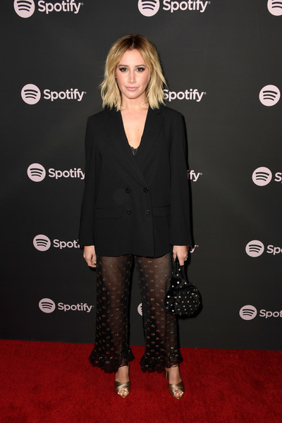 Ashley Tisdale matched her pants with a polka dot-embroidered wristlet.