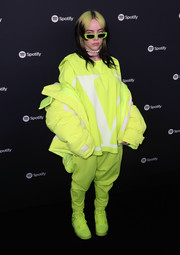 Billie Eilish completed her sporty attire with a pair of neon-green Air Jordan 4 Retro Flyknit Volt sneakers.