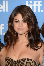 Selena wore her hair in long large spiral curls for the 'Spring Breakers' photocall in Toronto.
