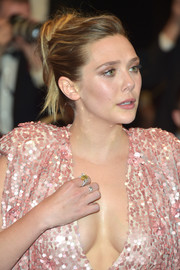 Elizabeth Olsen pulled her hair back into a loose bun for the Cannes Film Festival screening of 'The Square.'