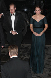 Kate Middleton looked breathtaking at the St. Andrews anniversary dinner in a teal Jenny Packham gown with a fitted wrap-style bodice.
