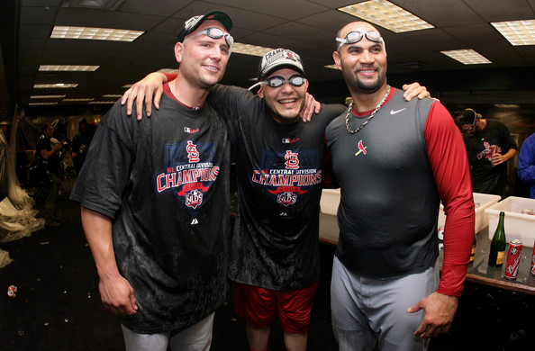 Albert Pujols wore a Nike  red and gray long sleeve t-shirt with a St Louis Cardinals logo on it.
