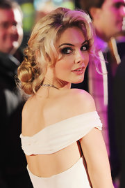 Tamsin Egerton had her tresses styled in a braided bun to match her goddess-cut gown.