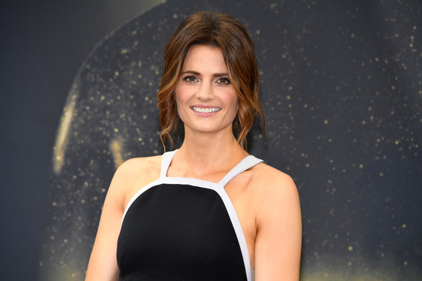 Stana Katic Loose Bun [absentia,hair,face,beauty,hairstyle,skin,fashion,blond,lady,shoulder,model,stana katic,photocall,monte-carlo,monaco,monte carlo tv festival]