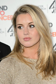Caggie Dunlop wore her straight blonde hair down at the Stand Up To Cancer fundraising event.