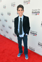 Cameron Boyce looked like a budding style star in his black velvet blazer, gingham shirt, and silk tie.