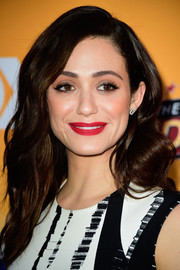Emmy Rossum added a bold pop of color with a matte red lippy.