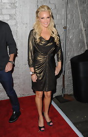 Bridget shimmered in a metallic bronze cocktail dress from the designer's Fall 2009 collection. This dress was not the most flattering silhouette for the blonde bombshell.