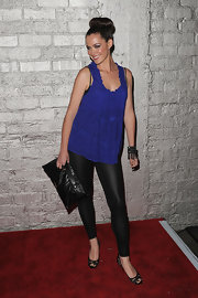 Christine Woods posed for the photog's as she flaunted her leather clad look. She pair her lace peep-toe heels with a black leather clutch.