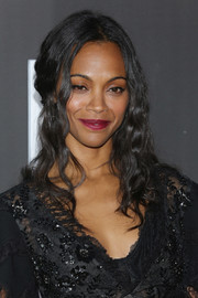 Zoe Saldana finished off her look with a berry lip.