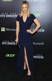 Abby showed just a peek of skin when she sported this midnight blue dress that featured two side cutouts at the waist and a thigh-high front slit.