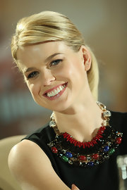 A fleshy-pink lip gloss gave Alice Eve a subtle touch of color during a 'Star Trek' press conference.