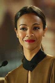 Zoe Saldana chose a classic low ponytail for her sleek and cool look at a press conference for 'Star Trek Into Darkness.'