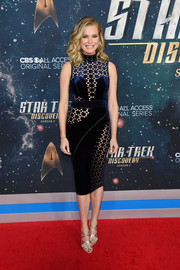 Rebecca Romijn styled her dress with strappy silver sandals by Sarah Flint.