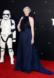 Gwendoline Christie had a grand red carpet moment at the 'Star Wars: The Force Awakens' European premiere in a flowing navy halter gown with a feathered bodice.