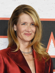 Laura Dern attended the 'Star Wars: The Last Jedi' photocall wearing her hair in a face-framing layered style with flippy ends.