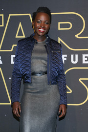 Lupita Nyong'o arrived for the 'Star Wars' Mexico premiere wearing a quilted blue bomber jacket over a silver dress.
