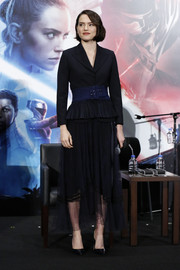Daisy Ridley attended the 'Star Wars: The Rise of Skywalker' press conference in Tokyo wearing a black peplum skirt suit with a contrast belt.
