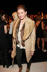 Lo wore fur on fur at the Rebecca Minkoff fashion show in a fur-trimmed wool coat over a thick fur vest.