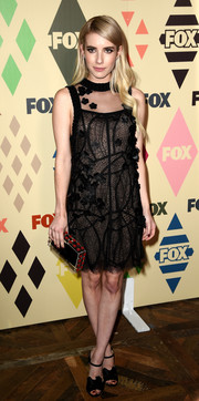 Emma Roberts finished off her ensemble with a Charlotte Olympia box clutch adorned with small red roses.