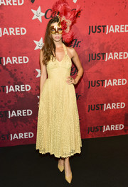 Angela Sarafyan kept it chic in a yellow lace halter dress at Just Jared's Halloween party.