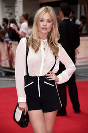 Laura Whitmore coordinated her outfit with a cute black-and-white shoulder bag when she attended the world premiere of 'The Bad Education Movie.'
