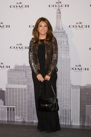 Mariam Camino brought shimmer to the Coach boutique opening with her sequined gold jacket.