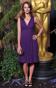 Berenice accessorized her purple pleated frock with black strappy sandals.