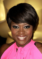 Viola Davis wore deep smoky grey shadow and softer sliver metallic shades to create her glamorous look at the 84th Academy Awards nominations lunch.