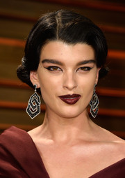 Crystal Renn looked vampy with her dark red lipstick.
