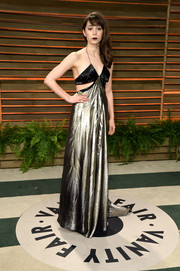 Aimee Garcia vamped it up in a silver and black halter gown with waist cutouts during the Vanity Fair Oscar party.
