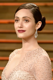 Emmy Rossum styled her hair into a chic twisted side bun for the Vanity Fair Oscar party.