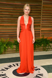 Kristen Bell showed her more daring side in a cleavage-baring red gown by Zuhair Murad during the Vanity Fair Oscar party.