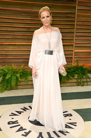 Maria Bello looked ethereal in a draped white off-the-shoulder gown during the Vanity Fair Oscar party.