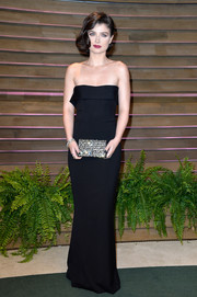 Eve Hewson added major sparkle to her look with a bejeweled Stuart Weitzman clutch.