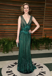 Evan Rachel Wood went for Gatsby glamour in a beaded green gown by Elie Saab during the Vanity Fair Oscar party.