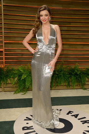 Miranda Kerr poured herself into a slinky silver Kaufmanfranco halter gown with a down-to-there neckline for the Vanity Fair Oscar party.