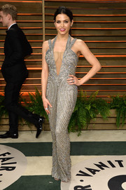 Jenna Dewan-Tatum was all glammed up in a figure-hugging beaded silver gown with a sexy plunge during the Vanity Fair Oscar party.