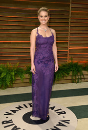 Alice Eve looked entrancing in a slinky, sheer purple lace gown by Alberta Ferretti during the Vanity Fair Oscar party.