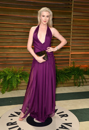 Ireland Baldwin looked bold and sophisticated at the Vanity Fair Oscar party in a purple Donna Karan halter dress with a deep plunge.