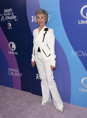 Rita Moreno looked impeccable in a white pantsuit with black detailing at the Variety Power of Women event.