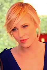 Natasha Bedingfield attended the Veuve Clicquot Polo Classic wearing her hair in a simple bobby-pinned updo with long side-swept bangs.
