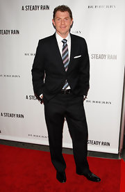 Bobby Flay showed off off his classic suit which he paired with a striped tie.