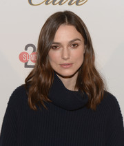 Keira Knightley wore her shoulder length hair in loose waves to Stella Artois At The Village At The Lift.